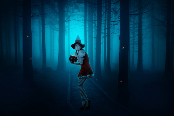 Dark Photo Manipulation of a Young Witch in a Forest