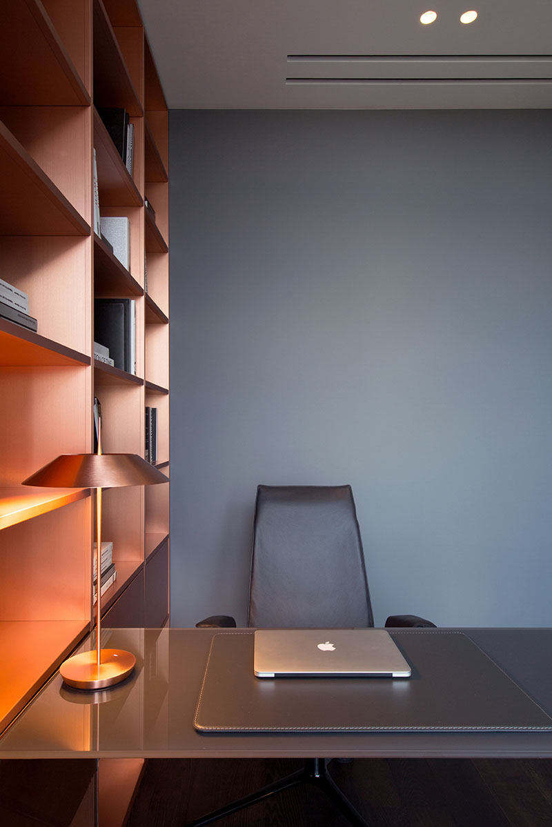 modern home office with copper shelving