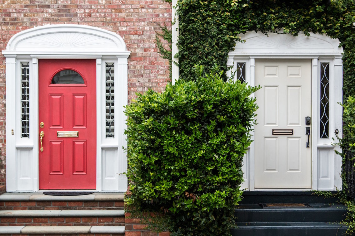 A photo of two doors in Charleston, South Carolina.