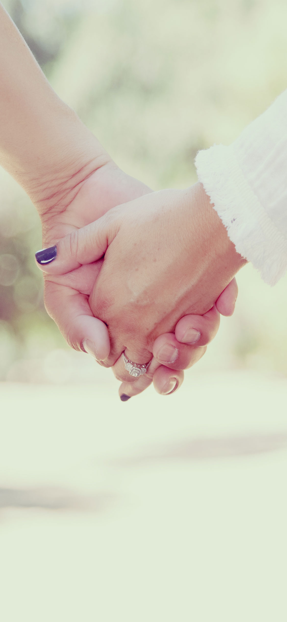 couple holding hands iPhone Wallpaper