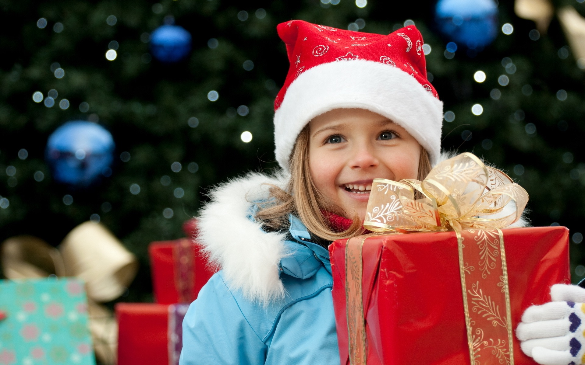 Cute Boy with Christmas Gifts Wallpaper