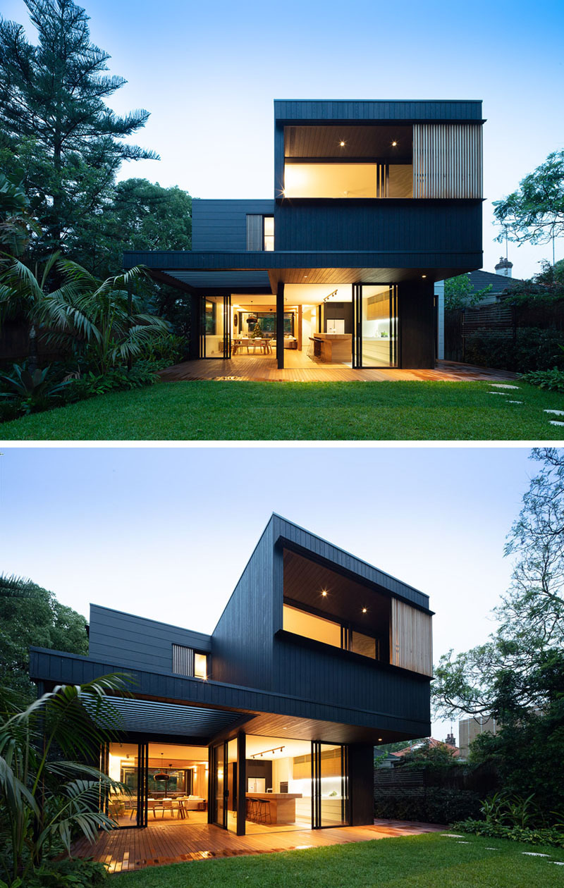 Light-Filled House Designed with Blackened Wood Siding Exterior